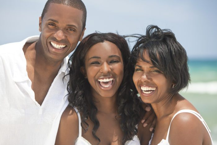 Happy American Family On Beach With Straight Teeth Invisalign for Teens and Adults Manassas VA
