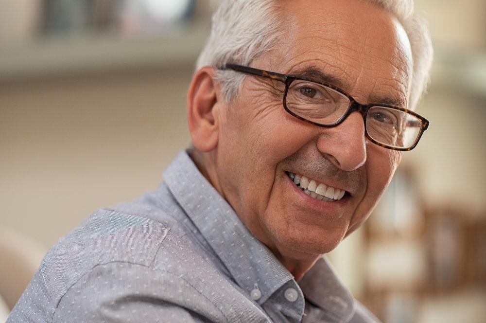 dental crowns Manassas | Older man smiling.
