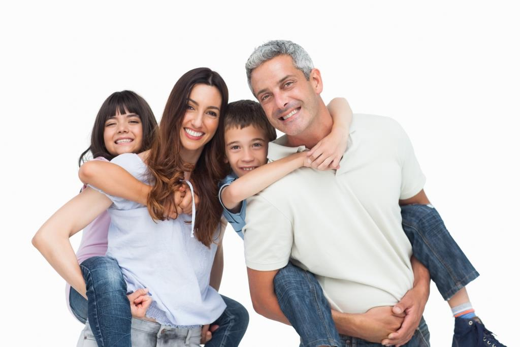 Cosmetic and Family Dentistry | Happy family smiling.